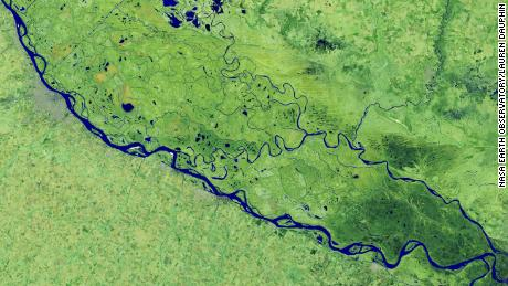 On July 3, 2020, Landsat 8 operational ground imager captured this false-color image of a river near Rosario, a major port city in Argentina.