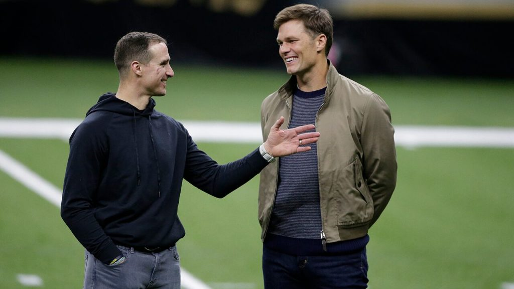 Drew Press and Tom Brady share a possible last minute on the field after the playoff match