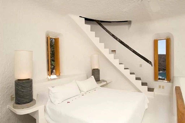 Luxurious: Bedrooms feature pure white cotton and stunning views