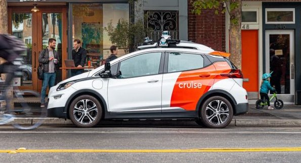 A white and red self-driving car parked on a San Francisco street