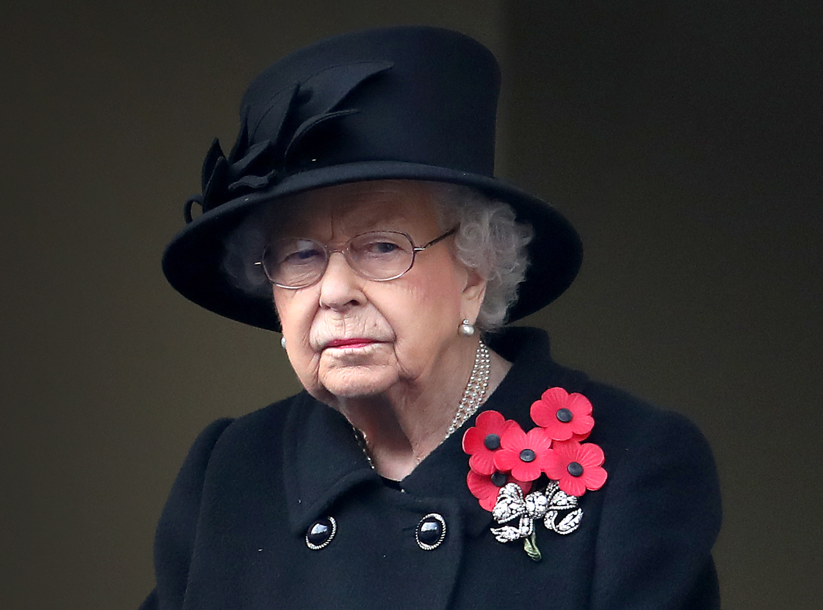 Queen Elizabeth II takes a glimpse during a memorial service at the memorial at The Cenotaph on November 8, 2020 in London, England.
